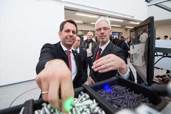 Lower Saxony's Minister for Economic Affairs, Olaf Lies tests the SAFELOG Poka Yoke Pick by Light at the Hanover Trade Fair